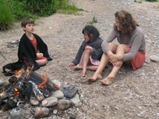 Talking round the fire on the family workshop