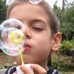 Blowing bubbles at a ceremony with other home educators